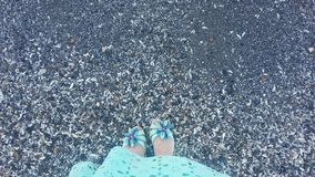 Girl by the sea, girl`s feet near the water Royalty Free Stock Images