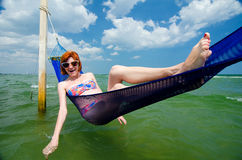 Girl in sea hammock Royalty Free Stock Photos