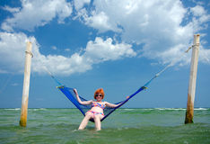 Girl in sea hammock Royalty Free Stock Image