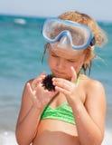 Girl with sea hedgehog Stock Image