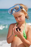 Girl with sea hedgehog Royalty Free Stock Image