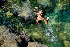Girl in the sea lagoon aerial top view Royalty Free Stock Photos