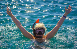 Girl in the sea in a mask for diving Stock Photos