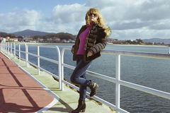 Girl in sea port Royalty Free Stock Photography