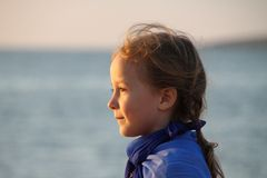Girl sea profile face sun Royalty Free Stock Image