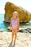 Girl on sea shore Stock Photos