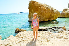 Girl on sea shore Stock Images