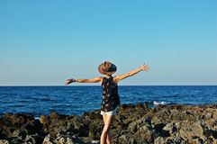 Girl on the sea shore. Girl on the sea shore feeling free Royalty Free Stock Images
