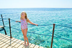 Girl on sea shore Stock Photography