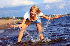 Girl and the sea spray. Royalty Free Stock Image