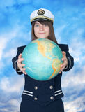 Girl in sea uniform and globe Royalty Free Stock Photos