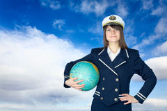 Girl in sea uniform and globe Stock Photos