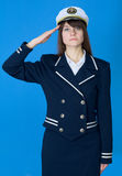 Girl in a sea uniform salutes Royalty Free Stock Photos