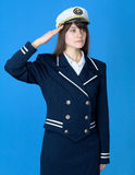 Girl in a sea uniform salutes Stock Photo