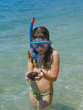 Girl with sea urchin. Girl in sea with diving mask keeping sea urchin in hands at Adriatic sea (Croatia-Dalmatia Royalty Free Stock Photo