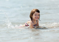 Girl in sea wave Royalty Free Stock Image