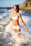 Girl in the sea waves. Happy beautiful girl in the sea waves Stock Photo