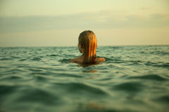 Girl in sea waves Royalty Free Stock Photo
