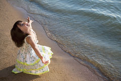 Girl on seacoast. Girl with the lifted hands on seacoast Royalty Free Stock Images