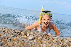 The girl on seacoast flounders about in water Royalty Free Stock Images