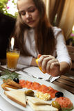 Girl in seafood restaurant Royalty Free Stock Photo