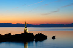 Girl with Seagull. In the dawn on the Adriatic coast in Opatija in Croatia Stock Images