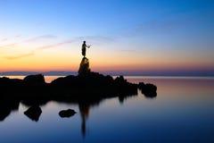 Girl with seagull. In the dawn on the Adriatic coast in Opatija in Croatia Stock Photos