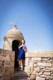 Girl and seagull. Little trip to Essaouira. Morocco royalty free stock photo