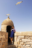 Girl and seagull. Little trip to Essaouira. Morocco royalty free stock images