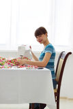 Girl seamstress and sewing machine Royalty Free Stock Image