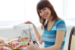 Girl seamstress and sewing machine Stock Photo