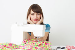 Girl seamstress and sewing machine Royalty Free Stock Photo