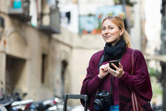 Girl searching for the direction using her phone in town Stock Photo