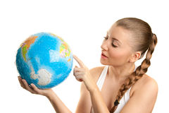 Girl searching on a globe of the world Stock Images