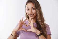 Girl searching key your heart. Attractive feminine tender tanned european woman curly hair, showing love gesture smiling royalty free stock image