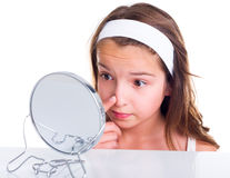 Girl searching for pimples Royalty Free Stock Images