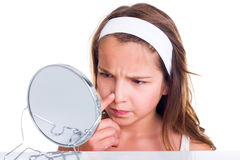 Girl searching for pimples Stock Photos