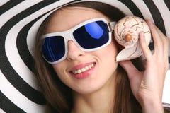 Girl with seashell Stock Photos