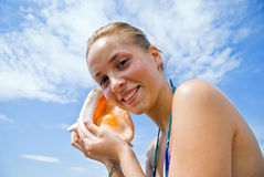 Girl with a seashell Royalty Free Stock Images