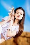 Girl with seashell Stock Photography