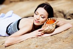 Girl with seashell Stock Image