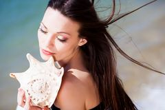 Girl with seashell Stock Photo