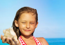 Girl and seashell Royalty Free Stock Images
