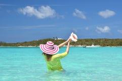 Girl with a seashell Stock Image
