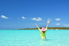 Girl with a seashell. In the turqouise water of Atlantic. Exuma, Bahamas Stock Photography