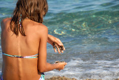 Girl on seashore Stock Photo