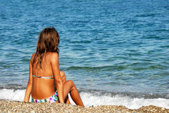 Girl on seashore Royalty Free Stock Photo