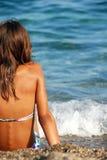 Girl on seashore Royalty Free Stock Photography