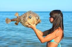 Girl on a seashore Stock Photos