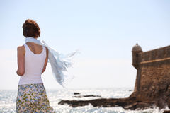 Girl on seashore Royalty Free Stock Images